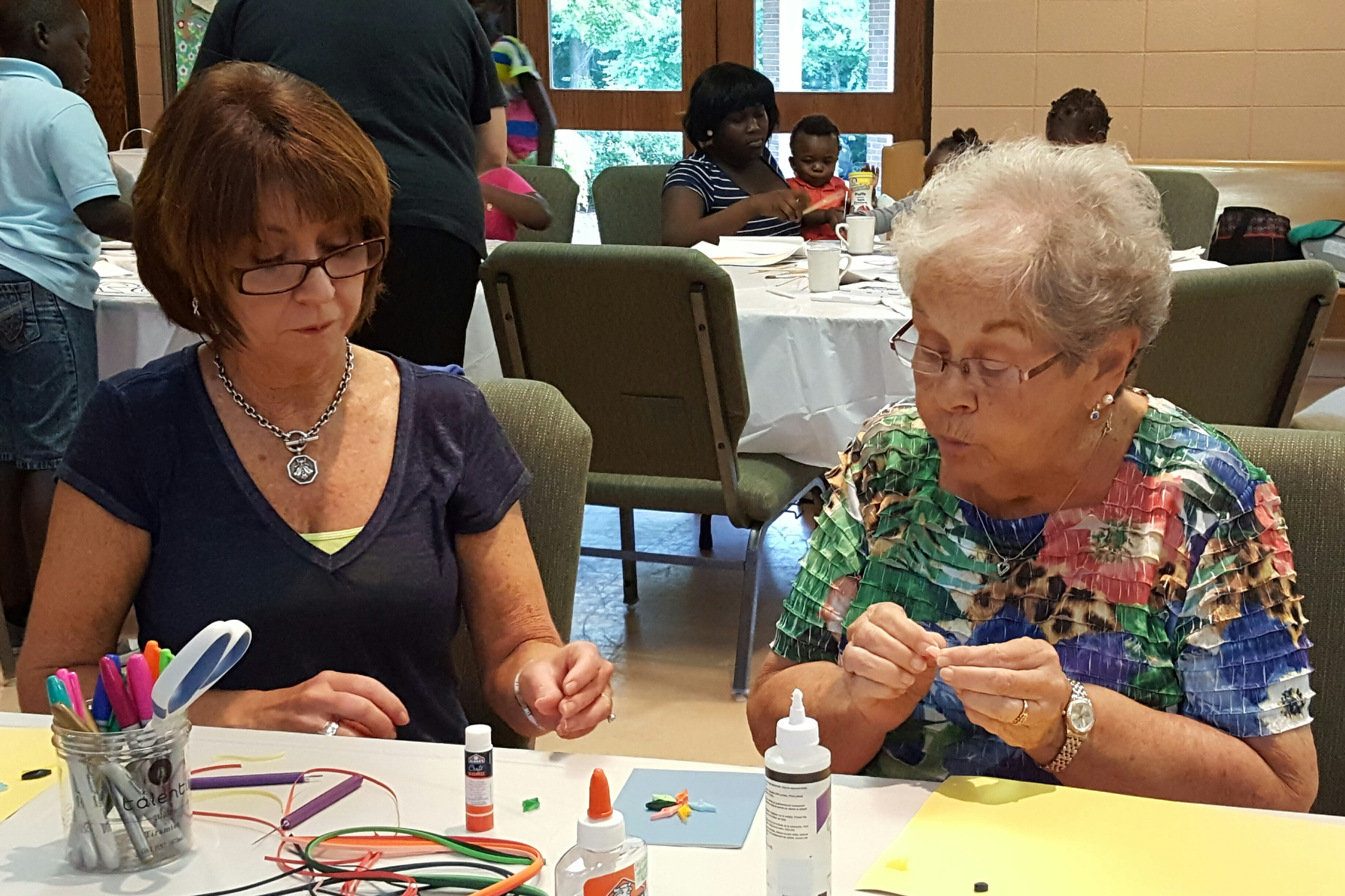 Betzy and Terri learning to quill paper